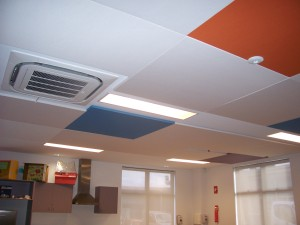 SerenityLite Panels in various fabric colours can reduce background noise and add vibrancy to an interior space like a classroom